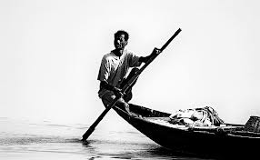 Finding enough fish to feed increasing population numbers -The Fisherman on the River Ganga (Ganges) by Sumit Sen